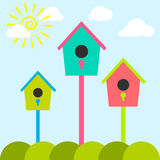 Nesting box cartoon set. Meadow with colorful bird houses. Stock Images