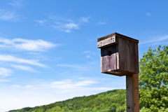 Nesting box in front of sunny background Royalty Free Stock Image