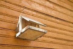 Nesting box on wooden background Stock Photo
