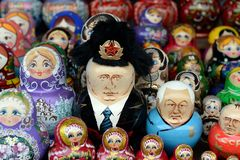 Nesting dolls depicting Russian presidents Vladimir Putin and Boris Yeltsin on the counter of Souvenirs in Moscow. Royalty Free Stock Photos