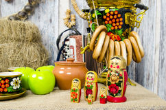 Nesting dolls at the samovar with bagels. Russian nesting dolls at the samovar with bagels Royalty Free Stock Photography