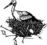 Nesting woodcut Stork Royalty Free Stock Image