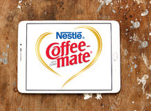 Nestle coffee mate logo. Logo of nestle coffee mate on samsung tablet on wooden background Royalty Free Stock Images