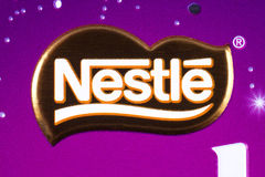 Nestle Company Logo. LONDON, UK - JANUARY 4TH 2017: A close-up of the Nestle logo on one of their confectionery products, pictured over a plain white background Royalty Free Stock Photography