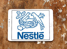 Nestle logo. Logo of nestle company on samsung tablet.Nestlé is the world`s leading nutrition, health and wellness company Royalty Free Stock Image