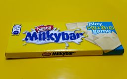 Nestle milkybar. Pack kept on a yellow background Stock Photography
