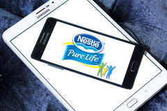 Nestle pure life logo. Logo of nestle pure life mineral water on samsung mobile on samsung tablet Stock Images