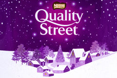 Nestle Quality Street. LONDON, UK - JANUARY 4TH 2017: A close-up of the Nestle Quality Street symbol on a tin of the product, on 4th January 2017 Royalty Free Stock Photography