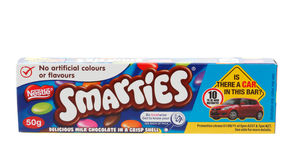 Nestle Smarties chocolate snack. A box of Nestle Smarties, fun colourful sweet crispy coated chocolate snack food.  White background Stock Photos