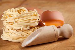 Nests of dry pasta. On wooden table Royalty Free Stock Photography