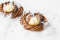 Nests with Easter eggs decorations Royalty Free Stock Photo