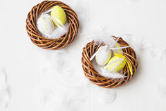 Nests with Easter eggs decorations Stock Photography