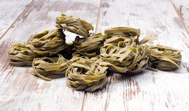 Nests green of pasta Royalty Free Stock Photos