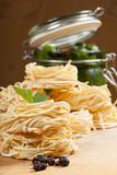 Nests of pasta. Nests of dry pasta on wooden table Stock Photography