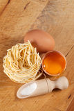 Nests of pasta. Nests of dry pasta on wooden table Royalty Free Stock Image