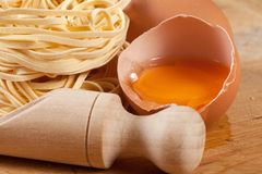 Nests of pasta. Nests of dry pasta on wooden table Royalty Free Stock Photography