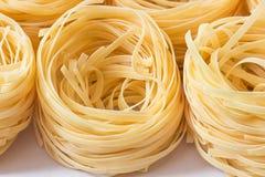 Nests, raw pasta,  pasta background. Shallow dof stock image