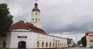 Nesvizh, Belarus. Square And Town Hall In Summer Day. Famous Landmark In Nyasvizh. Architecture Of 16th Century. Zoom. Zoom Out stock footage