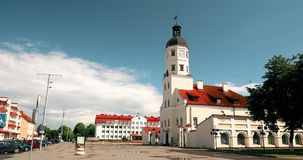 Nesvizh, Belarus. Square And Town Hall In Summer Sunny Day. Famous Landmark In Nyasvizh. Architecture Of 16th Century. Zoom, Zoom Out stock video footage