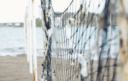 Net. Old net attached to the poles at the beach. Shallow depth of field added for more natural view Stock Photography