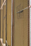 Net against pigeons on house. Balcony stock photos