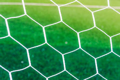 Net background over green grass of soccer field. Seletive focus on soccer  or football goal net over green grass field background Stock Images