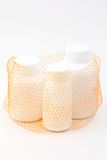 Net  bag container group of white medicine bottle Royalty Free Stock Image