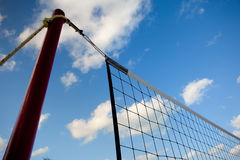 Net on beach and clouds Royalty Free Stock Photos