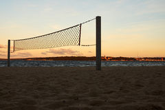 Net at the beach at sunset. Volley net at the beach at sunset Stock Photo