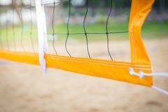 Net in the beach volleyball court. Background stock images