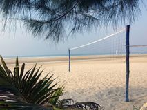 Net for beach volleyball on an empty beach.  royalty free stock image