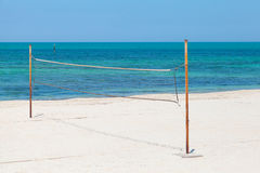 Net for beach volleyball on sea coast Royalty Free Stock Photo
