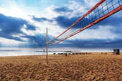 A net for beach volleyball. Net for beach volleyball at sunrise stock images