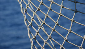 Net and Blue Sea Royalty Free Stock Photos