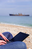Net book At The Beach Royalty Free Stock Image