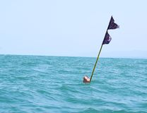 Net Buoy Marker Double Flag in Sea Royalty Free Stock Images