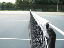 Net cord on tennis court royalty free stock photo