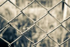Net fence. Retro color background Royalty Free Stock Photo