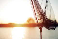 Net for fishing at lake during sunset -concept beautiful background Royalty Free Stock Image