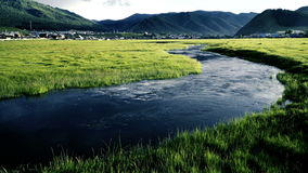 Net flows the river in a small valley among the mountains of the field. stock video