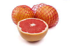 Net with fresh grapefruits on a white Stock Photo