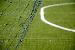 Net goal in soccer field. Close up of net goal in soccer field Stock Image