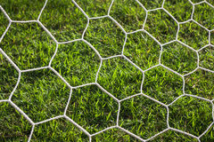 Net of goal soccer or football for background (select focus). White net for goal football, abstract of net, nets are made from rope, nets on blur green grass Stock Images
