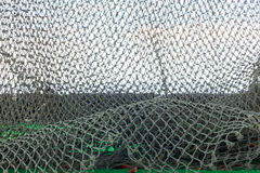 Net,grass,sky background. The Net,grass and the sky background Royalty Free Stock Images