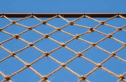 Net hung on iron bar. Against blue sky Stock Image