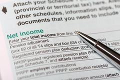 Net income form. Filling your net income for Canadian Stock Image