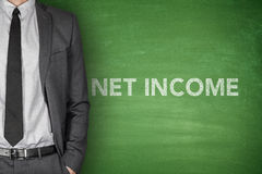 Net income text on green blackboard Stock Photo