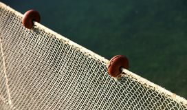 Net intact without fish but with some floats on the edge Stock Photo
