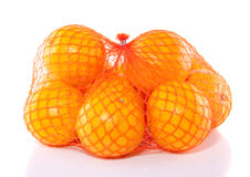 A net juicy oranges. Isolated on white background Stock Photos