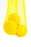 Net of lemons. A net of lemons isolated on white Royalty Free Stock Photo